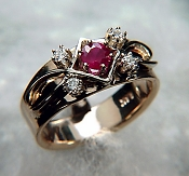 Hand made two tone ruby and diamond ring