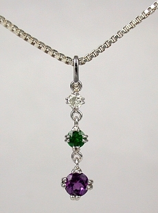 14KW amethyst, emerald, and diamond pendent