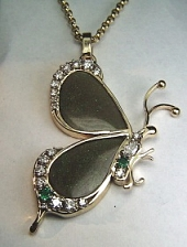 Opal butterfly pendant with diamonds and emeralds