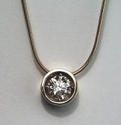 Bezel style diamond solitaire