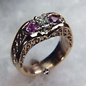 Custom Photoetched ring with emerald cut diamond and pink sapphires
