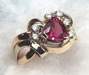 Trillion cut pink tourmaline ring with diamonds in 2 tone gold