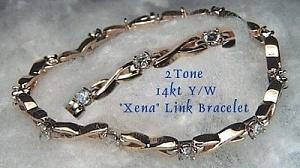 Xena Link bracelet in 2 tone 14KT gold