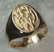 Photoetched 14kt yellow gold signet ring with the initials A J W