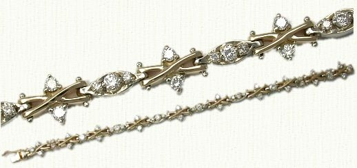Diamond Bracelet. This is a 14kt yellow gold X-link bracelet with over 3cts
