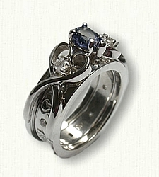 Twin Hearts 05: 14Kt white gold Twin Heart Reverse Cradle set with 7x5mm pear shaped Chatam Sapphire and two side diamonds
